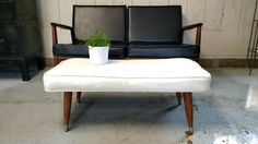 Covered in an off white vinyl. Tapered legs with metal tips. I found this covered in two different fabrics with Upholstered Footstool, Ottoman, White Leather Sofas, Leg Painting, Mid Century Decor, White Vinyl, Different Fabrics, Bench, Flooring