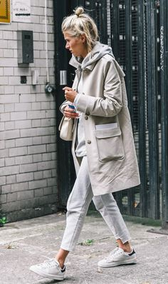 A hoodie layered under a trench coat.