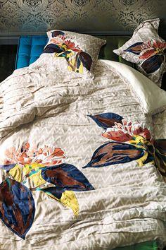 Pretty pretty bedding - love the splash of color on the soft neutral.