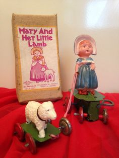Mary and her Little Lamb celluloid wind up toy. Excellent working condition. Wind her up and she goes in circles pulling her lamb with her.