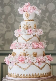 Lovely wedding cake with gold decor & pink roses.