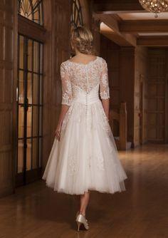 tea length long sleeves lace wedding dress http://www.misaislestyle.com/tea-length-3-4-sleeves-illusion-lace-wedding-dress.html