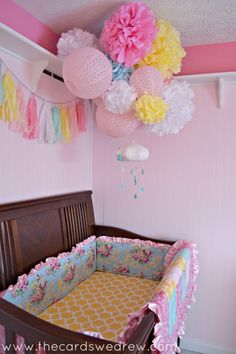 DIY Baby Nursery ... Love all those poms!