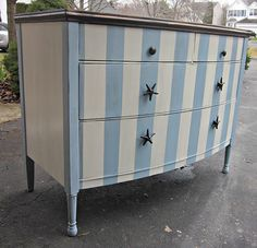 Freshen up an old dresser with bold stripes and new hardware for a cute kids room changing table.