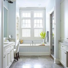 This spacious bathroom features a built-in bath and sit down vanity. More gorgeous bathrooms: http://www.bhg.com/bathroom/shower-bath/bathtubs-with-special-placement/?socsrc=bhgpin051813builtinbath=4