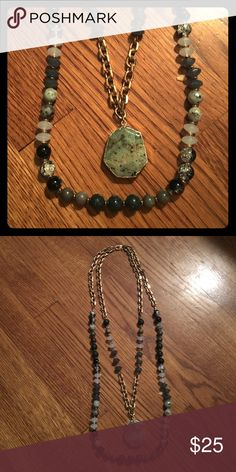 Chicos two tiered green necklace Great statement pics this two chain necklace would look great with any sweater it has multicolored green beads on two gold chains Chico's Jewelry Necklaces
