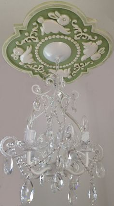 Nursery Bunny Ceiling Medallion by Marie Ricci. Shown in distressed pale green with 4 arm white chandelier. www.mariericci.com