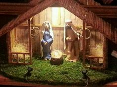Hand crafted nativity scene with polymer clay hand sculpted figures.
