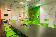 Spotify's office features a meeting room which can be opened up to provide a space for bands to perform. Fit out by bluuco