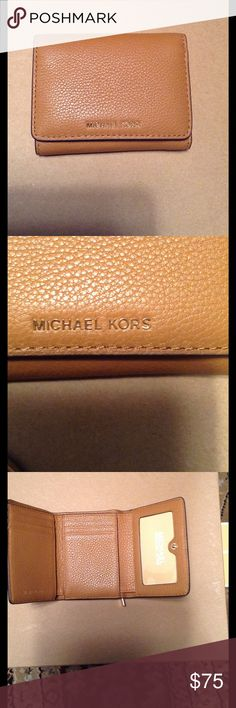 """💵MK WALLET Brand new """"LIANE""""  Acorn colored leather Sm Billfold wallet made by Michael KORS.  Wallet features 1 large slide pocket money holder, 6 CC slots, 1 ID or picture slot, 2 slide pockets for receipts or coupons, and one coin zipper pocket on the back of wallet.  All gold hardware. Brand new with tag's.  Comes with inside padding, care card and price ticket. Michael Kors Bags Wallets"""