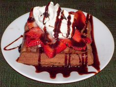 Chocolate Waffles with Strwberries and whip crem and of course the chocolate drizzle!