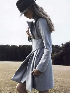 marl corset coat and trilby