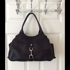 Cole Haan Black Leather Shoulder Bag Beautiful pebbled leather.  2 exterior pockets.  Main zip closure.  Front lobster claw pocket.  3 interior pockets (1 zips).  Great condition.  Interior is a little dirty.  Measures: 12.5x4.5x8.25x8.5. Cole Haan Bags Shoulder Bags
