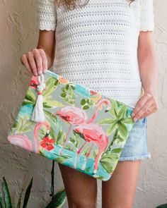 Pink Flamingo Oversized Zipper Pouch & iPad Pro Case  We love our flamingos here in Florida! I designed this giant pouch in honor of that rad pink bird. Vibrant coral pink flamingos cover the whole bag, balanced out by a grey background and vibrant blues and greens throughout. The colors are happy and playful and flamingos always make me smile so I couldnt resist this print.  This is a BIG pouch that can easily be used as a clutch purse and carry whatever you might need throughout the day...