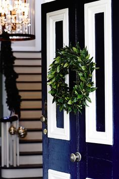 A lush wreath on the front door invites guests to get into the Christmas spirit. Tour the rest of this festive home. Photography: Derek Swalwell | Story: Australian House & Garden