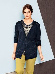 Cardigan sweater has a front in an ultra-fashionable see-through crochet knit…