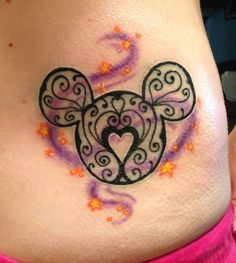 New Tatto! We go to Disney every year and since my favorite princess is repunzel, I had my artist incorporate her colors to make Mickey whimsical!