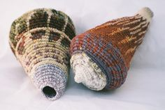 """Two shells each 6"""" long, tapestry-crochet in mixed yarns and wire by Caroline Routh.    Tapestry crochet is a type of crochet in which you carry multiple yarn colors across the piece to produce a fabric that looks not just crocheted but intricately woven."""