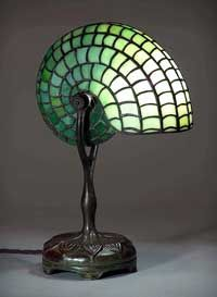 Nautilus lamp, a Tiffany lamp. The first Tiffany lamp was created in part of the Art Nouveau movement. Originally designed by Clara Driscoll, not Louis TIffany (as believed previous to Beautiful, intricate, and whimsical. Tiffany Stained Glass, Stained Glass Lamps, Tiffany Glass, Leaded Glass, Mosaic Glass, Glass Art, Art Nouveau, Antique Lamps, Vintage Lamps