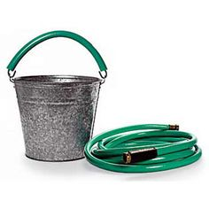 Love the idea of using old lengths of garden hose to cushion metal bucket handles! via This Old House