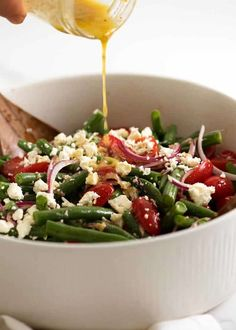Drizzling lemon dressing over Green Bean Salad with Cherry Tomatoes and Feta ~ Recipe Tin Eats Cherry Tomato Recipes, Cherry Tomato Salad, Cherry Tomatoes, Juicy Baked Chicken, Baked Chicken Breast, Green Bean Salads, Green Beans, Tomato Benefits, Lemon Salad Dressings