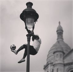 A weekend without football is no weekend at all.  #france #paris #sacrecœur #football #soccer #artistic #artist #acrobatics #streetart #streetphotography #streetlife #church #building #icon #bundesliga #sommerpause #morefootball #blackandwhite #travel #iloveparis .:. photo by: @miss_elbneedle