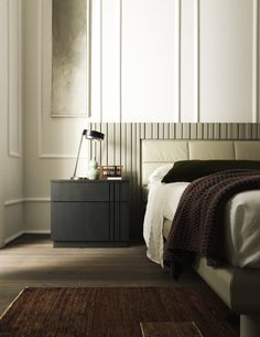 Stylish rectangular nightstand available in a wide variety of wood colour finishes and with the option of Swarovski crystal inserts and left or right facing. Certain to lend a sophisticated touch to any bedroom into which it is placed. A fine piece.