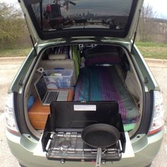 Life in a Prius (because who needs bathrooms... wait none of these car dwellings have bathrooms. yeesh.). Chris Sawey