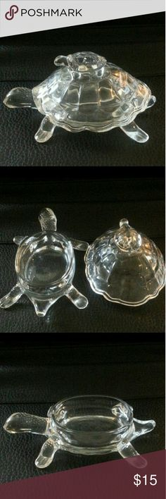 """10"""" Crystal Turtle Candy Box This crystal turtle candy box will add beauty to any corner of your home. Place it on your dresser or on your buffet; it's also the perfect addition to your figurine collection. Holding its head high, this turtle box features exquisite shell-like detailing all around, and the baby turtle on its back serves as a knob for easy lifting. Place it on any table to catch the light and elicit compliments from guests. Other"""