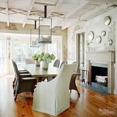 Two French doors lead from the kitchen to the calm and inviting dining room. A hand-painted mural of a waterfront view creeps along the walls. With its exposed ceiling, handmade table, and old Savannah-style mantel, the simple setting bears a rough elegance.