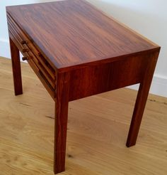 ILLUM WIKKELSO ROSEWOOD NEST of TABLES | From a unique collection of antique and modern nesting tables and stacking tables at https://www.1stdibs.com/furniture/tables/nesting-tables-stacking-tables/
