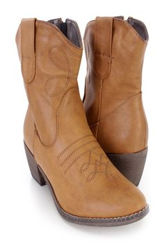 These stylish cowboy ankle booties feature a faux leather upper with a stitched design throughout, pointed closed toe, inner side zipper closure, smooth lining, and cushioned footbed. Approximately 2 1/4 inch heels.http://www.amiclubwear.com/riding-boots.html