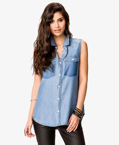 A sleeveless chambray shirt featuring a basic collar. Mock buttoned flap chest pockets. Pointed yoke. Full button placket. Contrast stitching. Woven. Unlined. Lightweight.