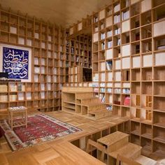 Read a bit? | This house by Kazuya Morita Architecture Studio in Osaka Prefecture, Japan, is completely lined with with pine shelves to display the owners' extensive collection of books.