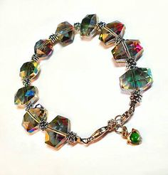 Only $7.95 on Etsy! - SALE Hexagonal Aurora Borealis Prism Hue Glass Bead Bracelet w/Metallic Stacked Findings & Silver Dolphin Jade Gemstone Charm FREE SHIPPING https://www.etsy.com/listing/259793274/sale-hexagonal-aurora-borealis-prism-hue