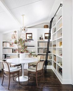 A rolling library ladder has long been on our dream home list, but now we need to add a cozy reading nook that looks just like this gem crafted by Redesign Home. Home Library Design, House Design, Design Desk, Muebles Home, Style Me Pretty Living, Tulip Table, Home Libraries, Dining Nook, Dining Chairs