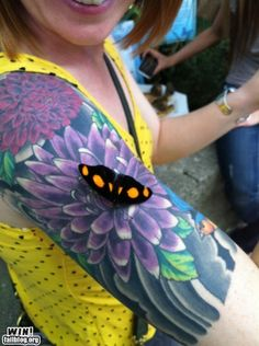 Neat tattoo....Sweet butterfly thought it was a real flower.