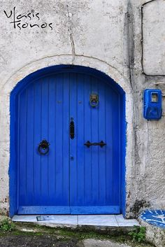 Old doors. By Vlasis Tsonos. Corfu, Greece.