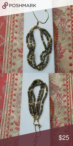 Beaded Bracelet on chain Excellent condition no signs of wear.  Chain is adjustable by pulling to fit your size. Three strands of Crystal and gold beads. Jewelry Bracelets