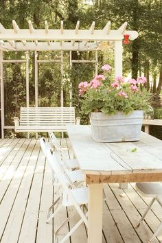 erin's art and gardens | arbor, porch swing, light color decking, very relaxing atmosphere.