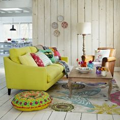 Spring decorated living room with bud green sofa