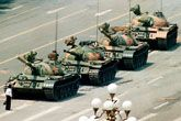 """Tank Man  """"It all started with a man in a white shirt who walked into the street and raised his right hand no higher than a New Yorker hailing a taxi,"""" James Barro"""
