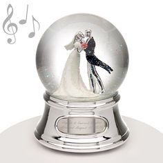 "Musical Water Globe - Wedding Couple - A treasured keepsake for the newlyweds! This water globe features a bride and groom about to kiss so it makes a great wedding gift. Add your own engraved message to make it an exceptional gift! When wound up the song that plays is ""Mendelssohn's Wedding March."""