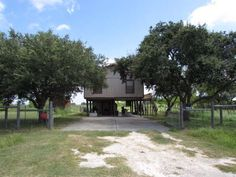 Stilt (Island Style), Single Family - ROCKPORT(HOLIDAY BEACH), TX This cute little coastal getaway located in quiet Holiday Beach offers 2 large bedrooms & 1 full bath w/stand up shower. Enjoy the wrap around balcony w/beautiful backyard views of the wildlife, birds, & pond. With no neighbors to ever build behind you, you will enjoy the peaceful surroundings & short drive to the private community pier. The subdivision offers a private community pool, pier, & playground for its residents for…