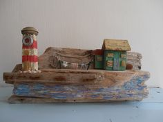 Light house cottage. All made from driftwood. Sea side art design by Philippa Komercharo.