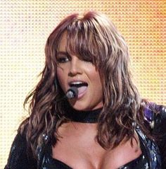 THE hairstyle that i want. Britney Spears medium length wavy light brown hairstyle with front bangs