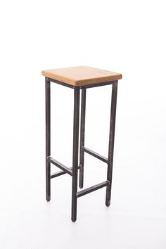 Bar stool, industrial style made with steel square tube and English oak seat.I can make seats in any wood type. Raw steel finished with beeswax. Powder coating available in pretty much any colour you like.Optional heights. Feet have plastic inserts so that they don't damage floors