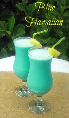 Blue Hawaiian ~ One of the MOST Tropical cocktails around! 1 Part Blue Curacao - 2 Parts Coconut Cream - 2 Parts White Rum {I use Malibu} - 4 Parts Fresh Pineapple Juice - Broken Ice - Fresh Pineapple Pieces, to garnish Blue Hawaiian Cocktail, Hawaiian Cocktails, Hawaiian Punch, Hawaiian Luau, Fancy Drinks, Cocktail Drinks, Cocktail Recipes, Pool Drinks, Blue Drinks