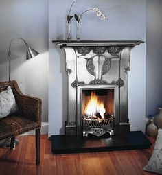 Intriguing fireplace that combines art nouveau stylistic elements and natural lines with the top of raw metal medium that would later become one of the driving themes of art deco design.