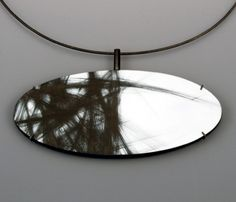 Julia Turner - 'Border' Neckpiece in steel, wood, and paint. Pendant measures approx. 4 x 1.6""